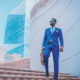 Business Man standing on Stairs of building